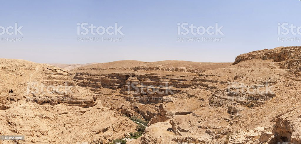 Steep strata walls of Kidron River canyon panoramic view royalty-free stock photo
