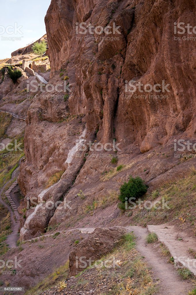 Steep towering rock and ruins of Alamut mountain fortress, Iran stock photo