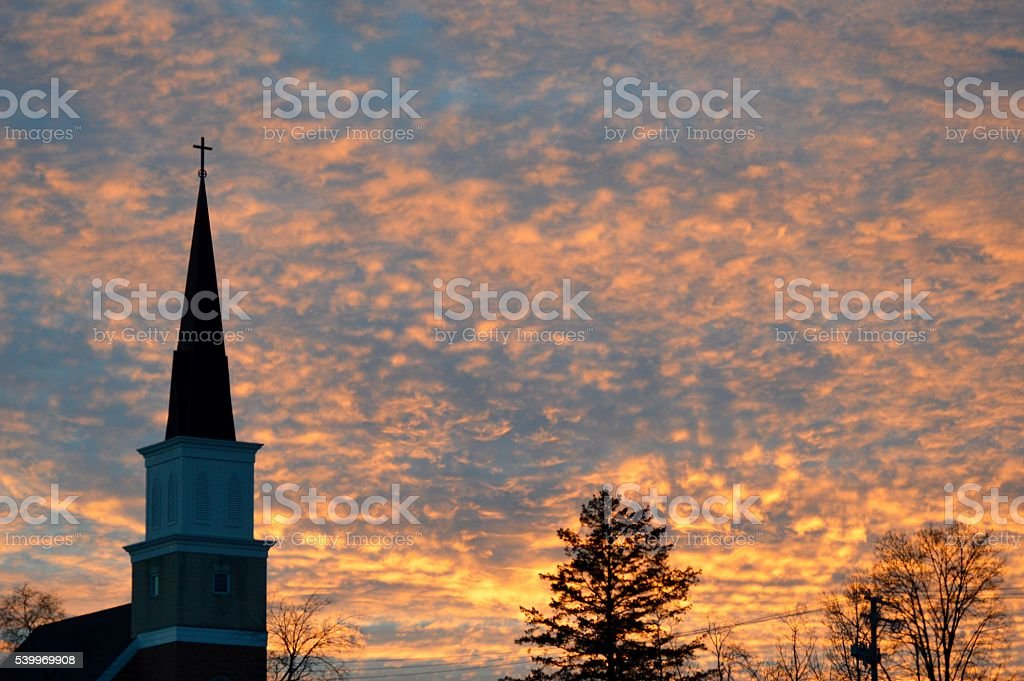 Steeple & Colorful Sunset Sky stock photo