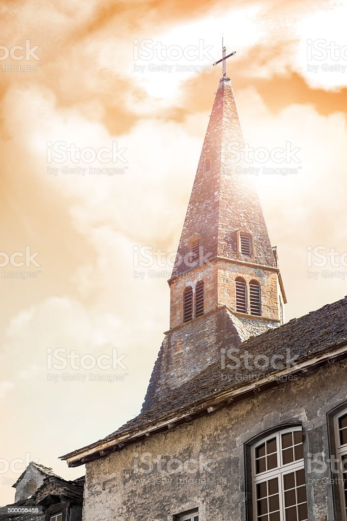 Steeple from french Augustinian Convent building at orange sunset sky stock photo