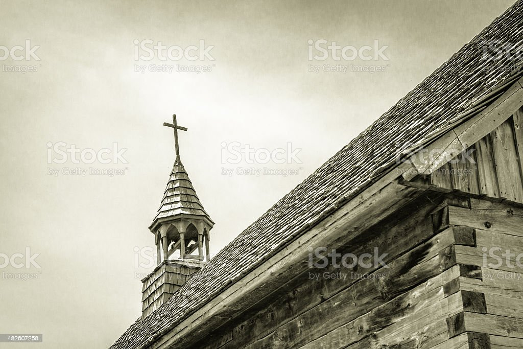 Steeple Of Old Wooden Church In Black And White stock photo