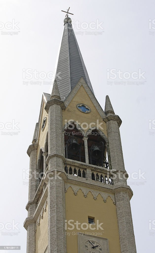 steeple of the Catholic Church with bells stock photo