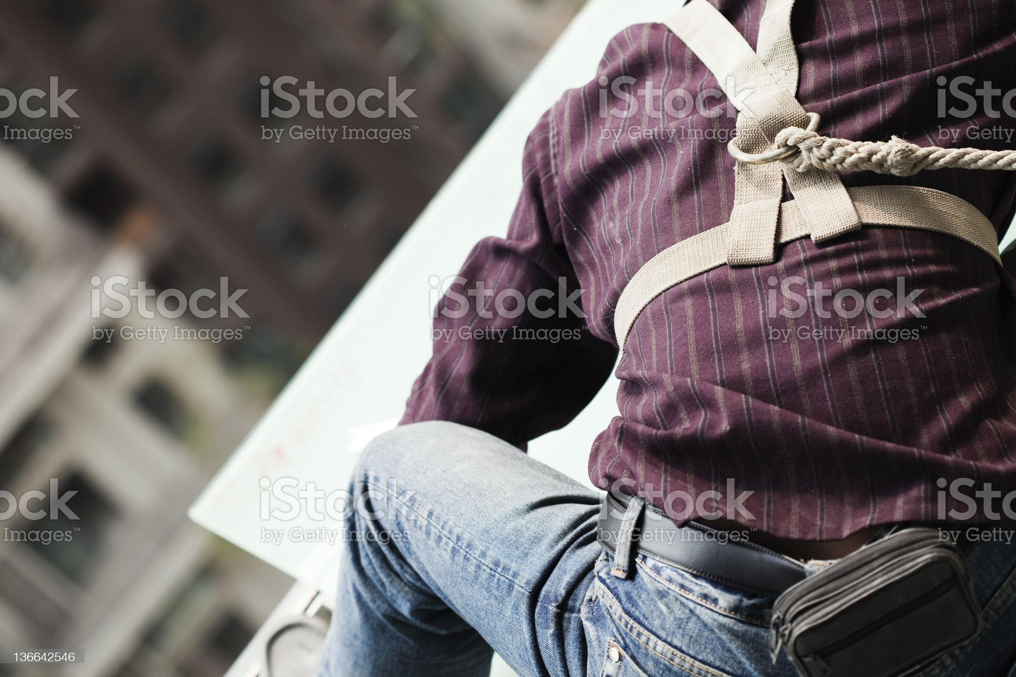 Steeplejack install glass roof on high building royalty-free stock photo