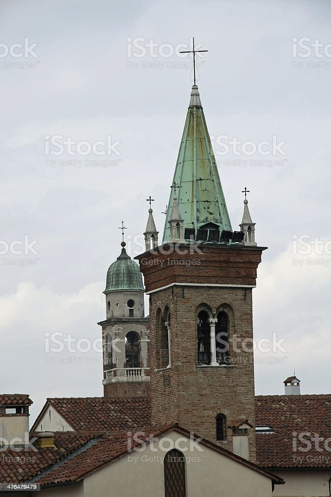 steeples of churches that rise above the houses royalty-free stock photo