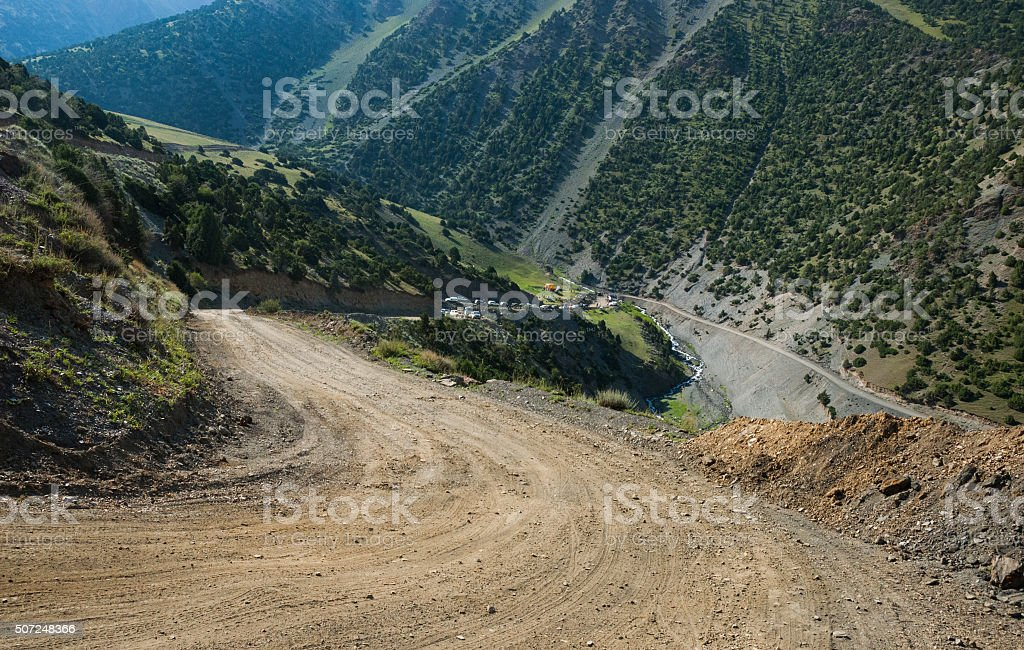 Steeproad in mountains stock photo