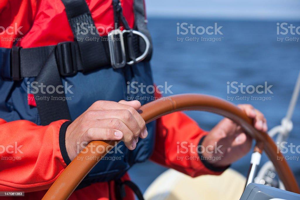 Steering a sailboat royalty-free stock photo