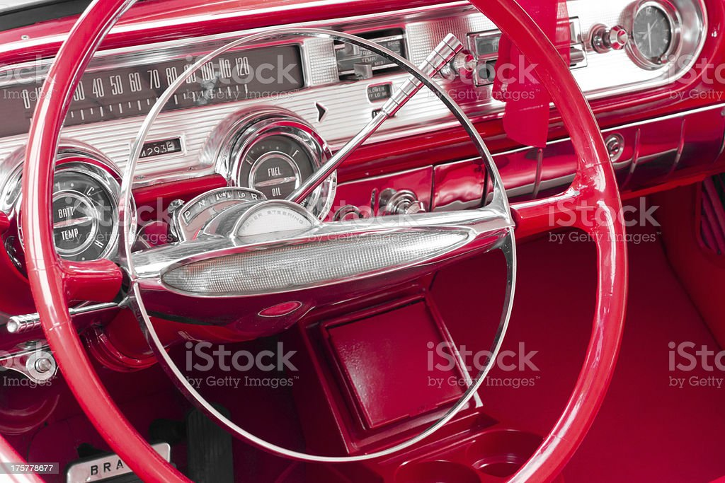 Steering wheel and dashboard of an old retro amercan car royalty-free stock photo