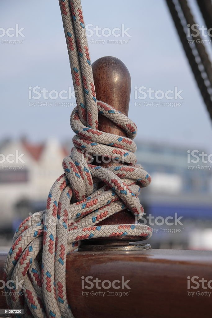 Steering wheel and rope stock photo