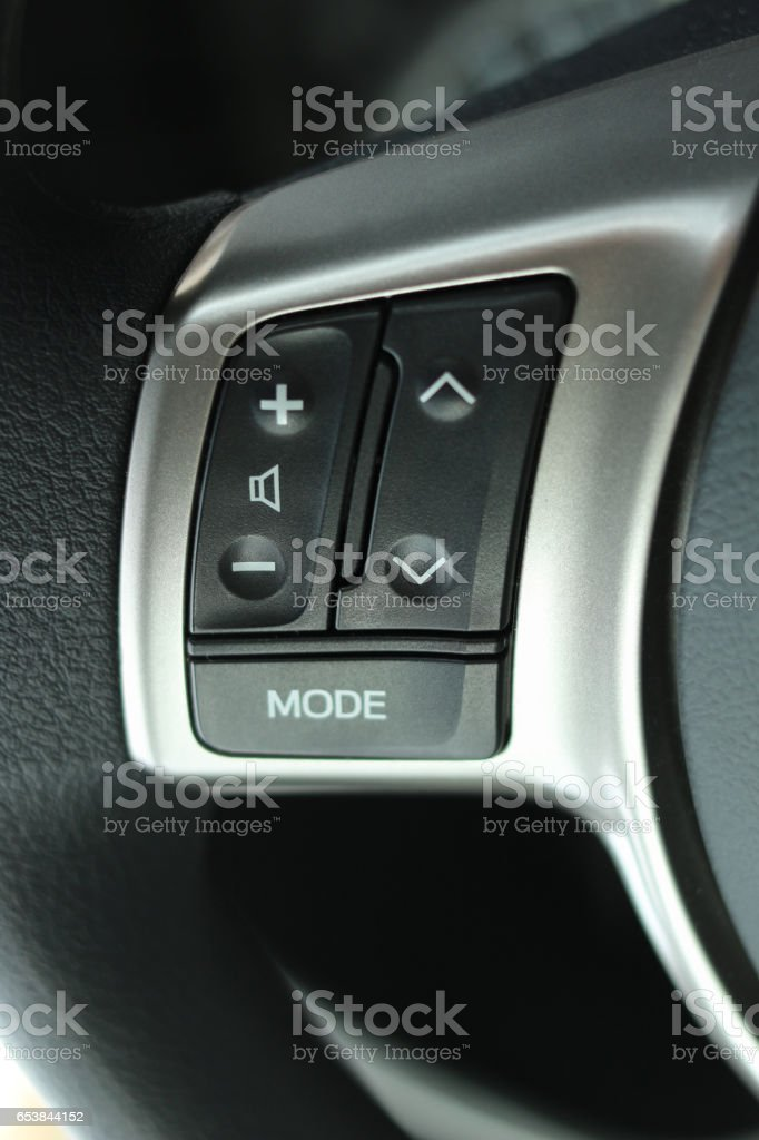 Steering wheel audio control button stock photo