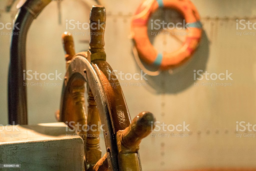steering wheel in boat cabin stock photo