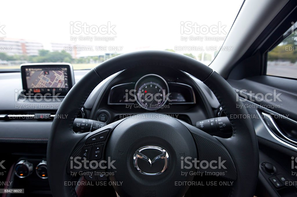 steering wheel of Mazda CX-3 and logo. stock photo