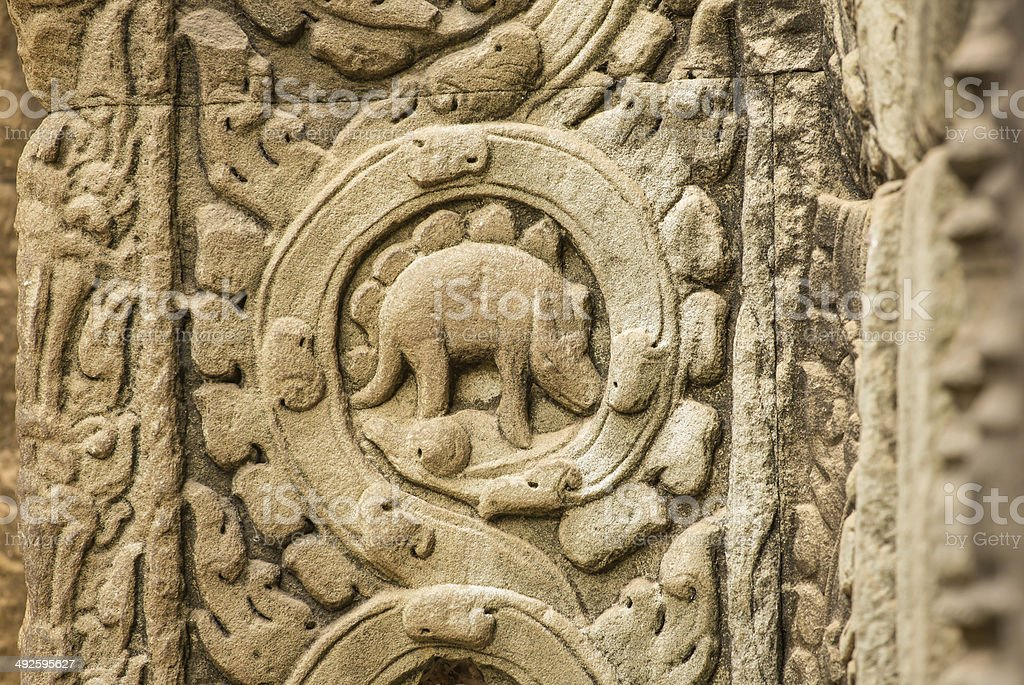 Stegosaurus bas-relief on the wall of Ta Prohm stock photo