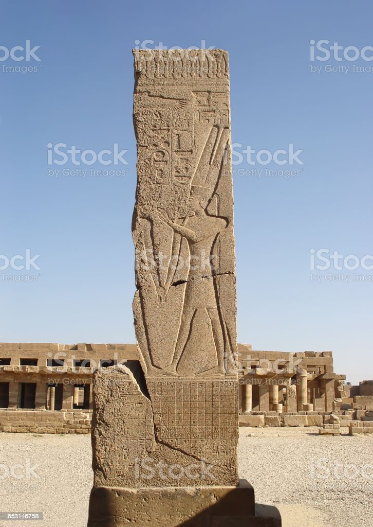 Stella depicting the god Amun on the background Festival Hall of Thutmose III. stock photo