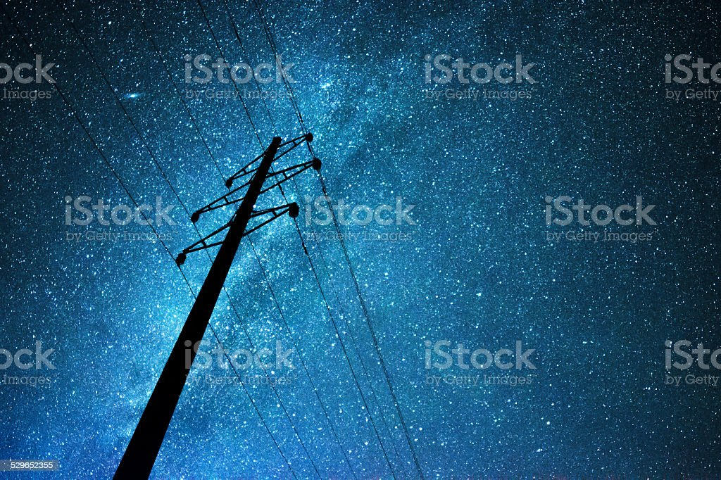 Stellar sky over the transmission line stock photo