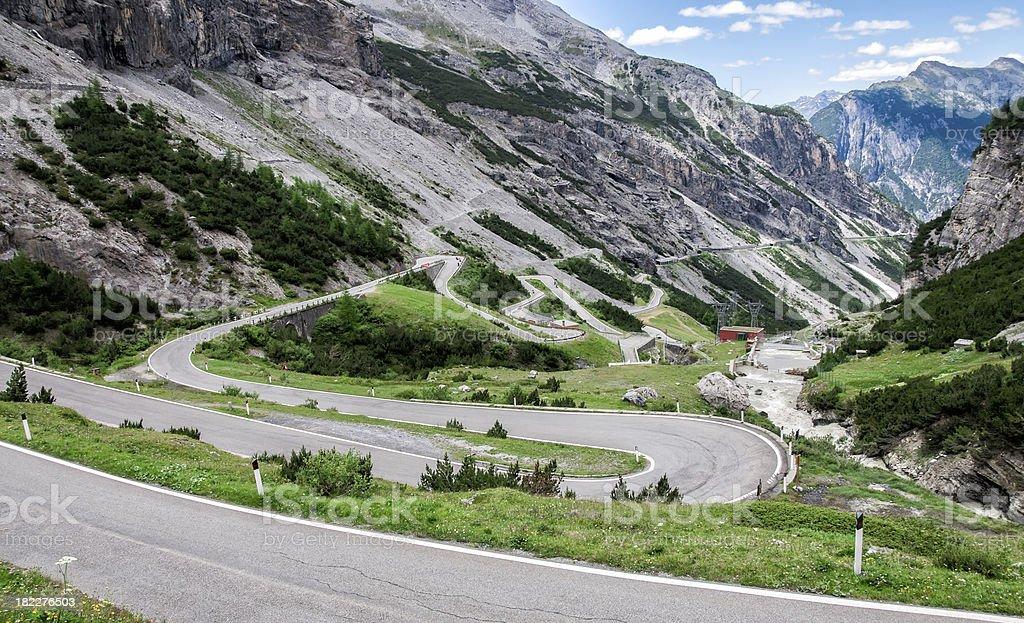 Stelvio Pass with very curvy road through the mountains stock photo
