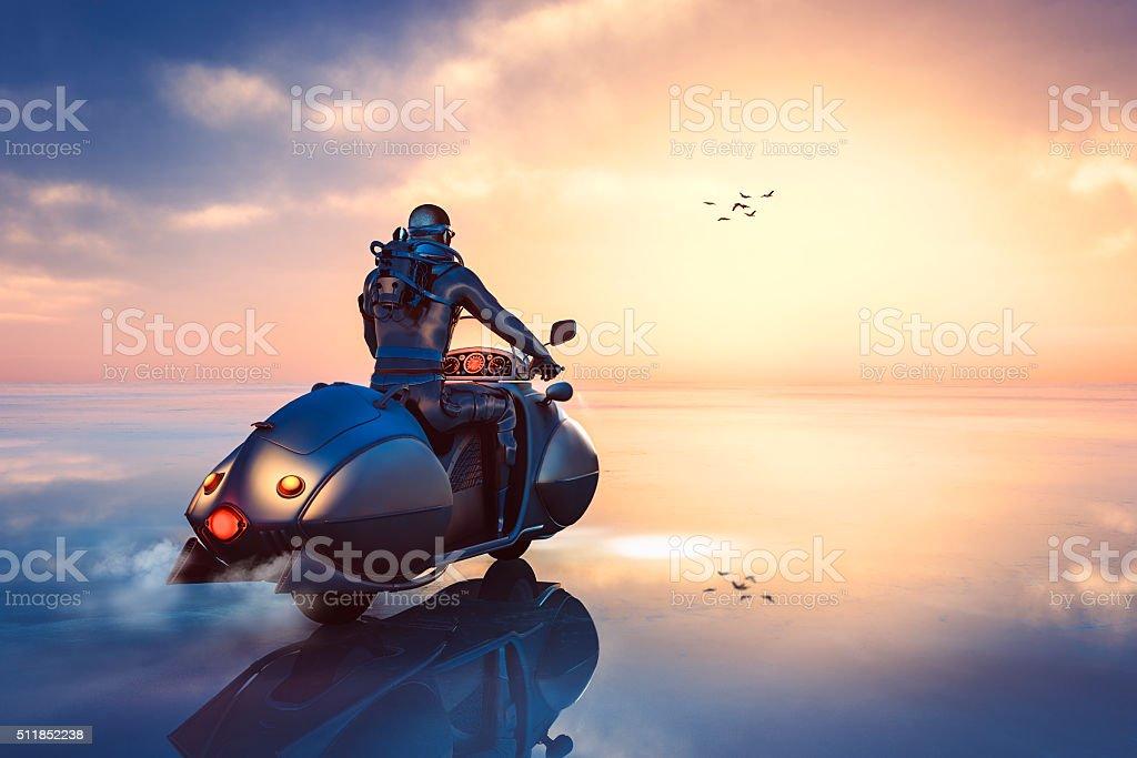 Stempunk biker driving through frozen fantasy landscape stock photo