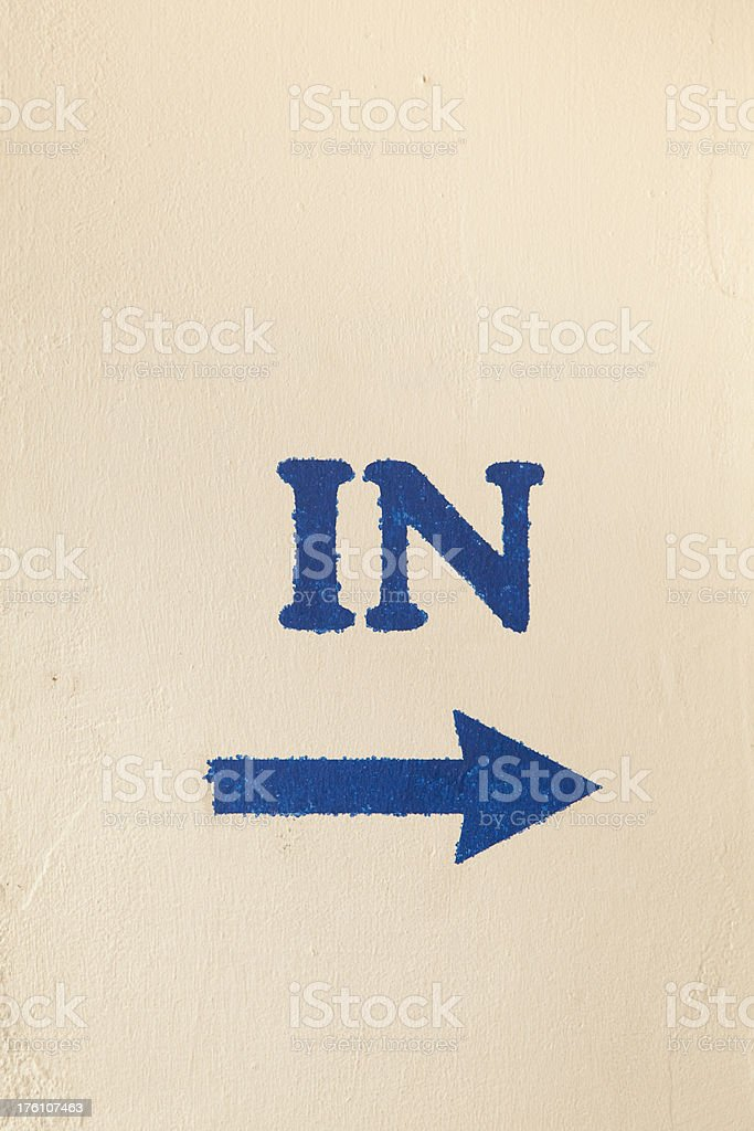 Stenciled Sign Points the Way to Entrance royalty-free stock photo