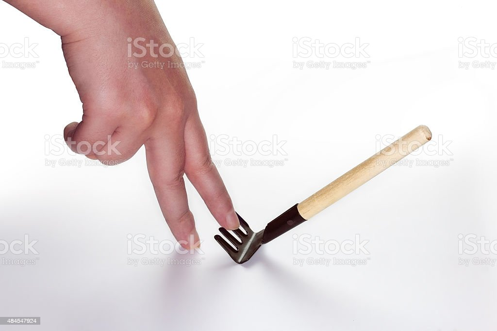 step on rake stock photo