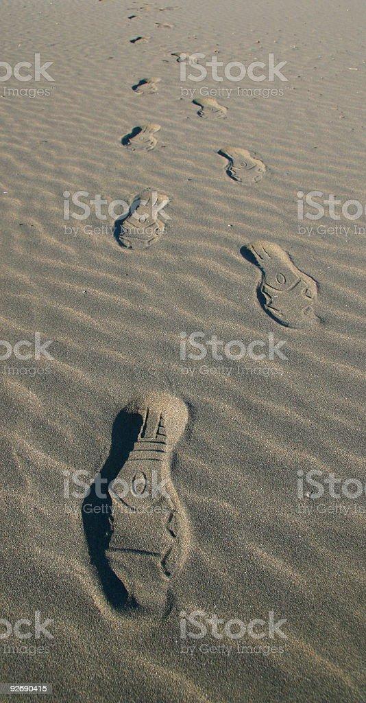 Step prints on sand stock photo