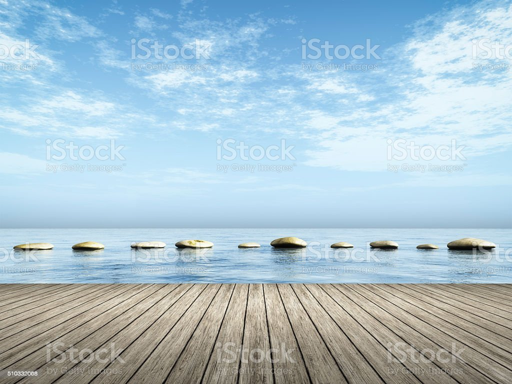 step stones in the blue sea stock photo