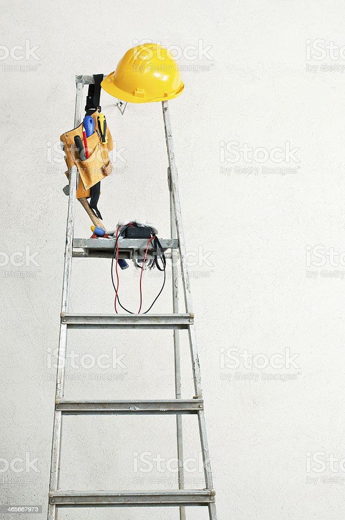 stepladder near the concrete wall and tools royalty-free stock photo