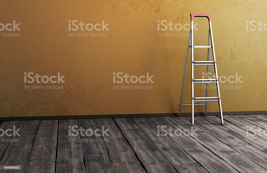 Stepladder near the wall on old wooden the floor stock photo
