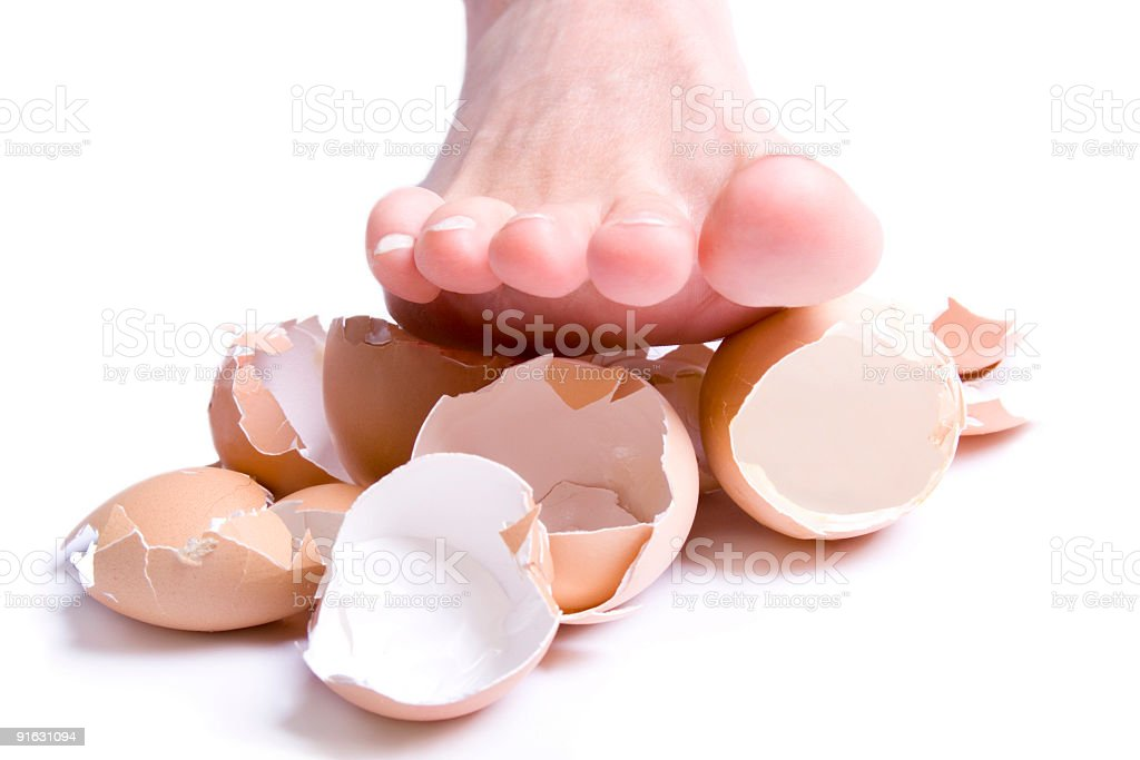 Stepped on eggshells stock photo
