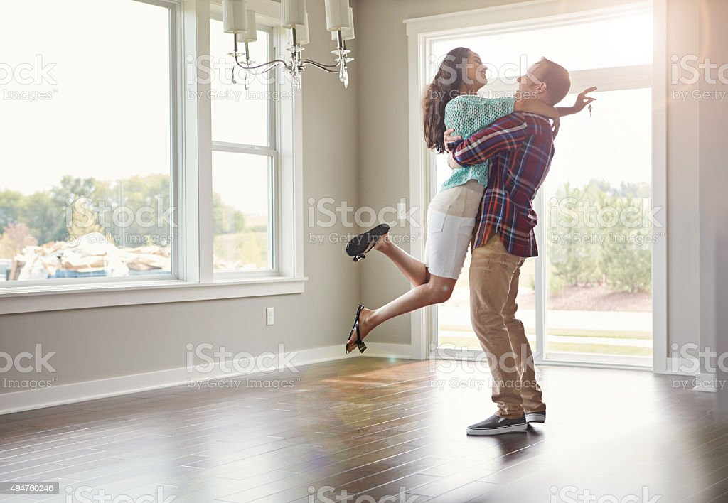 Stepping into their new life together stock photo