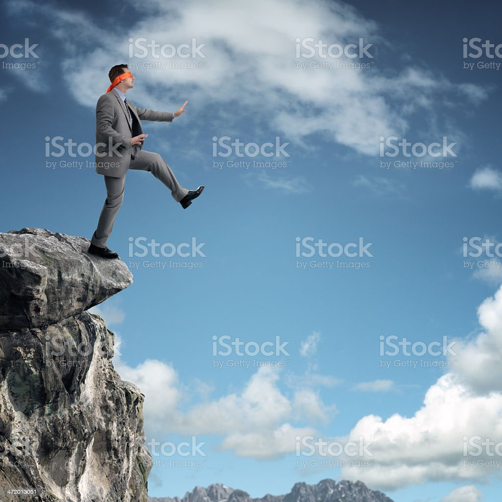 Stepping off a cliff ledge stock photo
