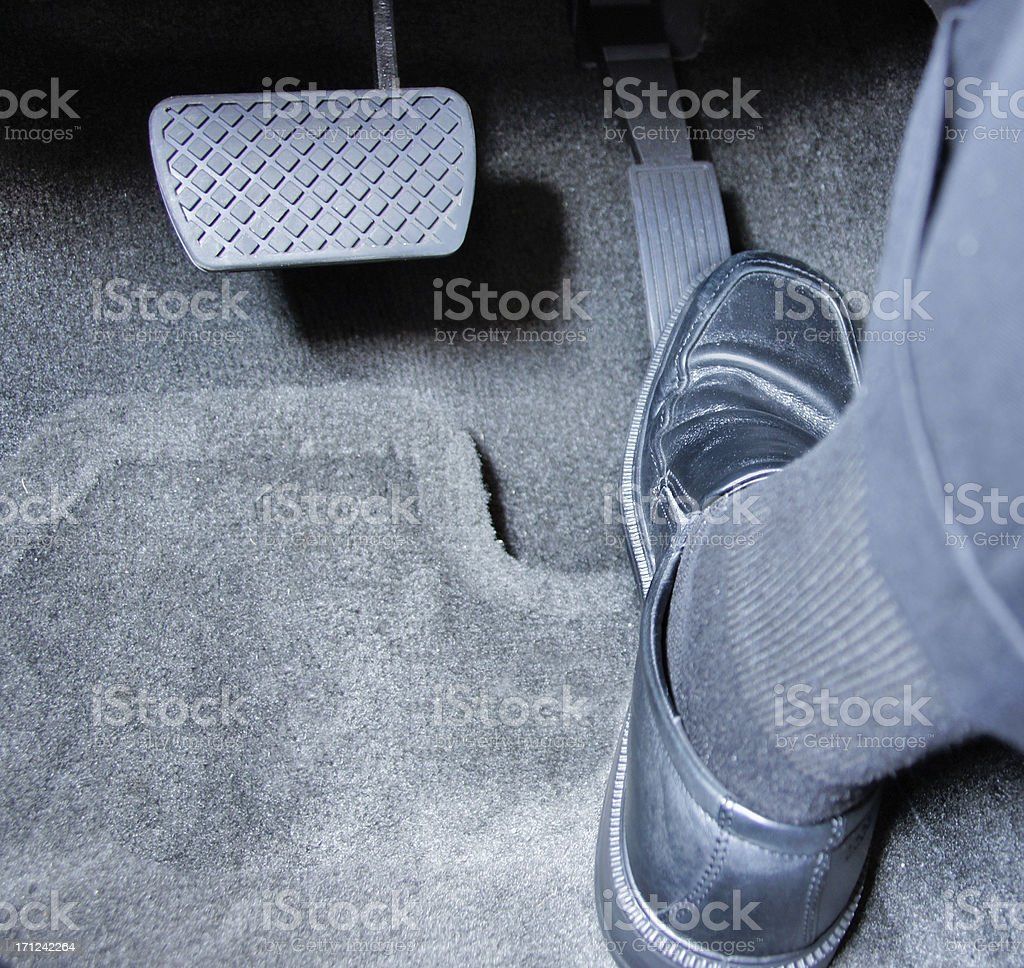 Stepping on gas pedal stock photo