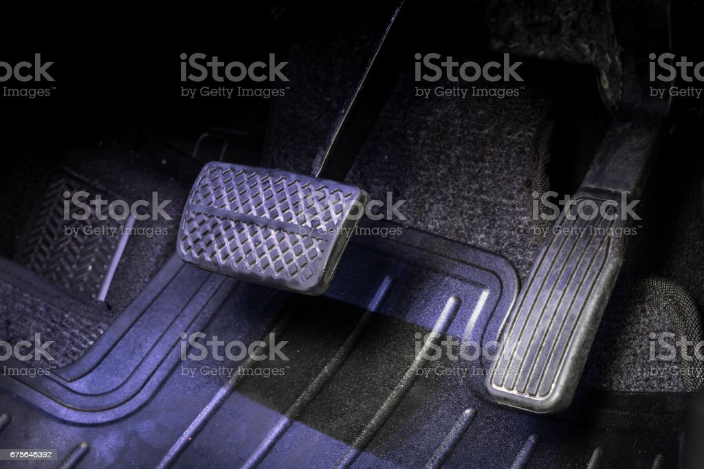 Stepping on gas pedal. stock photo