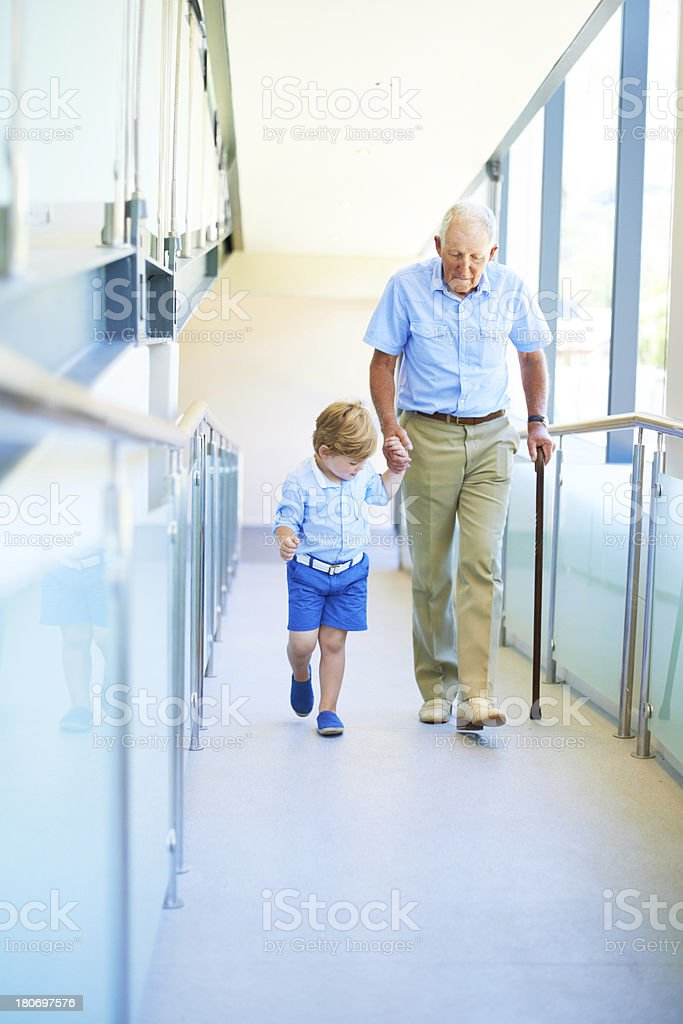 Stepping out with grandad stock photo