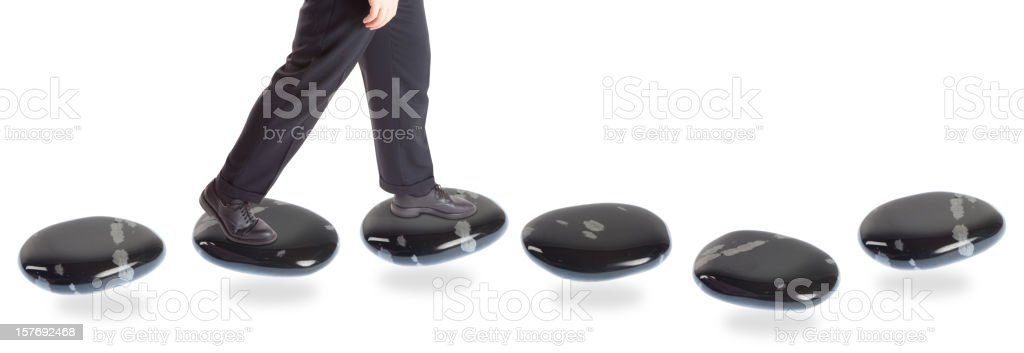 stepping stone concepts: going forward stock photo