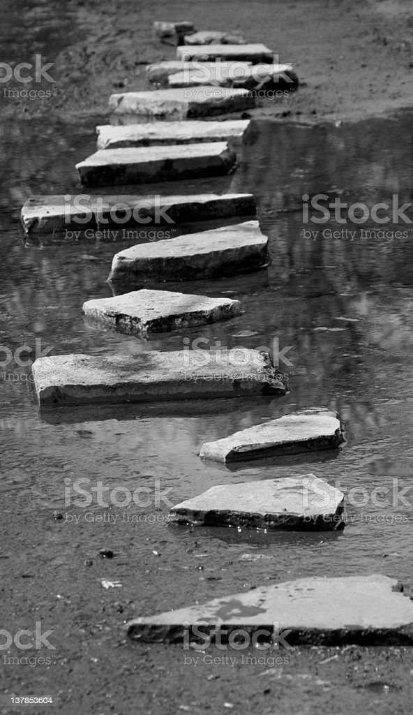 Stepping stoned through a shallow stream stock photo