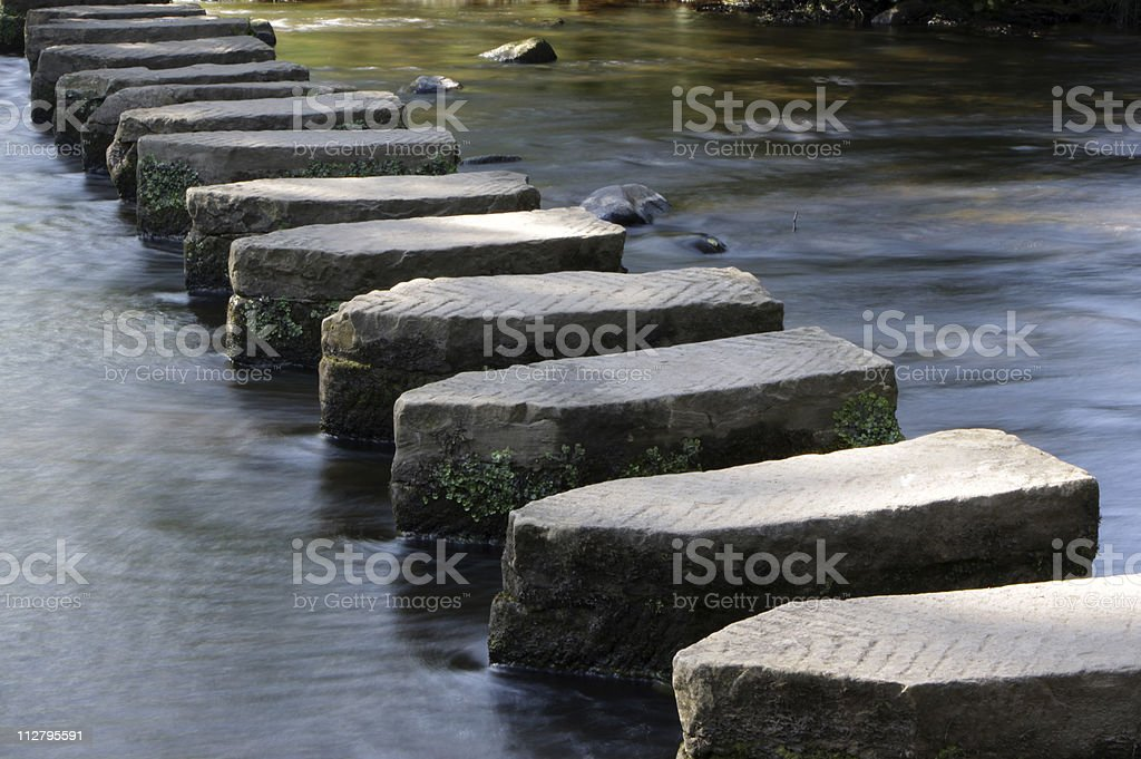 Stepping stones across a river royalty-free stock photo