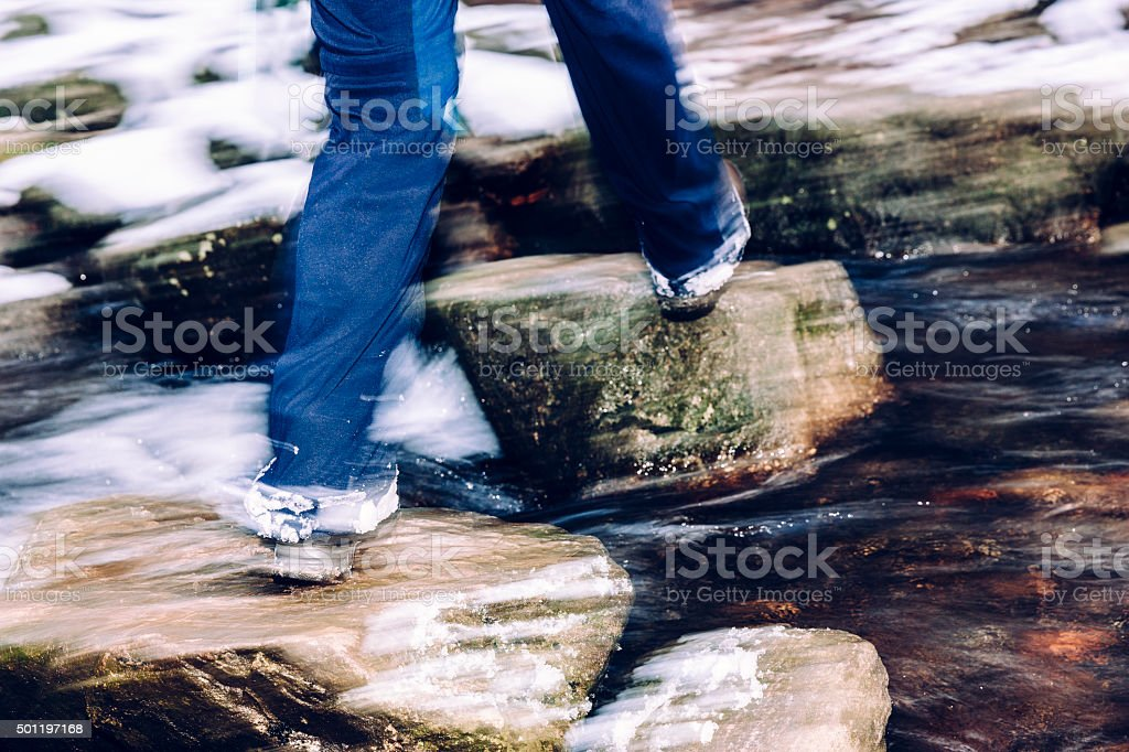 Stepping stones across stream stock photo