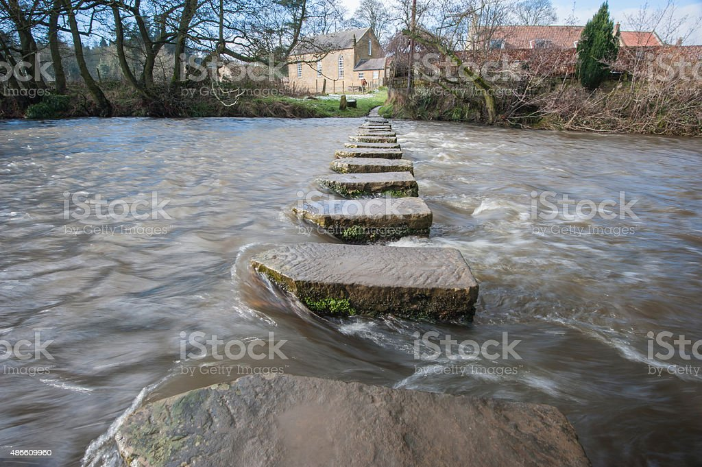 Stepping stones over a small river stock photo
