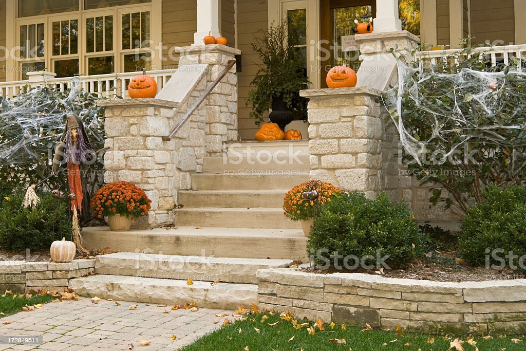 Steps and porch of a house with Halloween decorations  stock photo