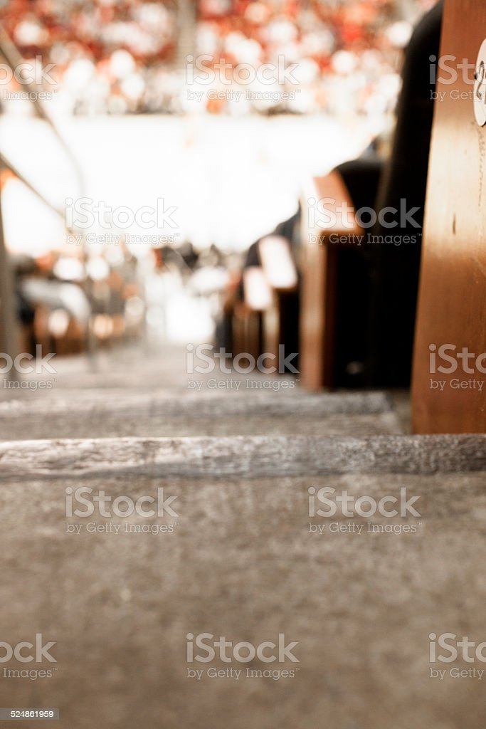 Steps at basketball sports stadium. Crowd of fans. Court. Seating. stock photo