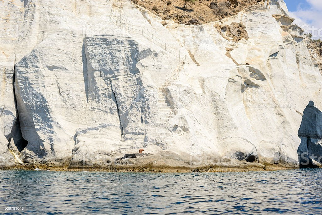 Steps carved in a steep limestone rocky cliff stock photo