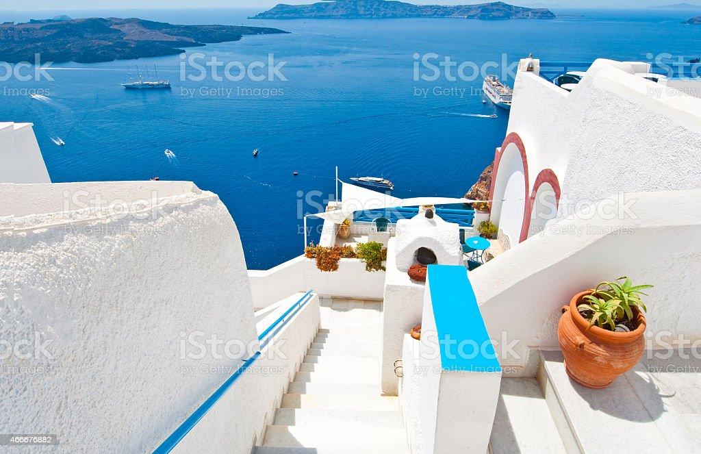 Steps down to the Idyllic patio in Fira. Thera(Santorini), Greece. stock photo