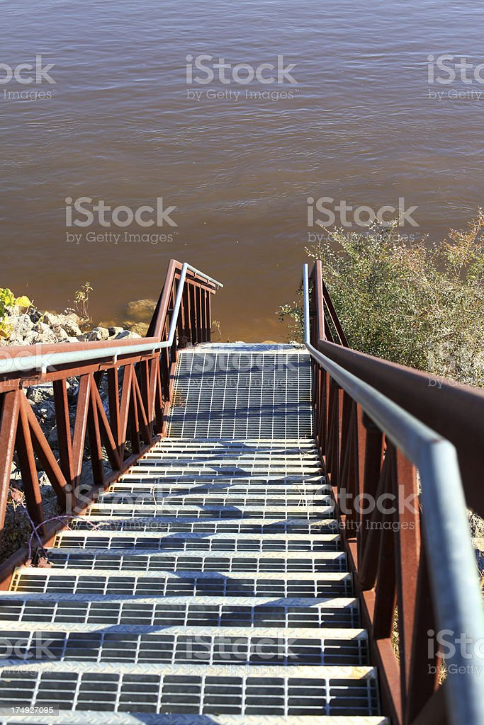 Steps lead down to the muddy Mississippi River royalty-free stock photo