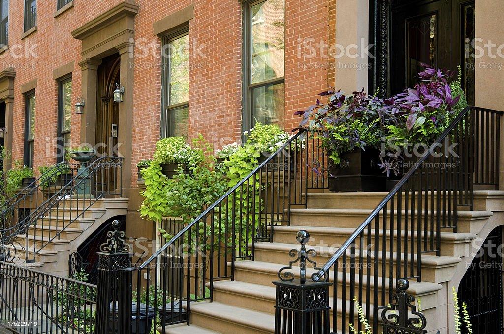 Steps leading up to entrances of homes in Brooklyn Heights royalty-free stock photo