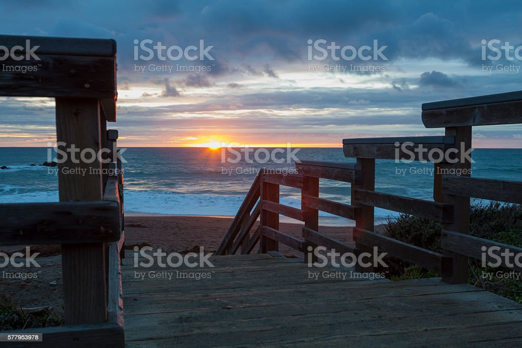 Steps to the beach with sunset stock photo