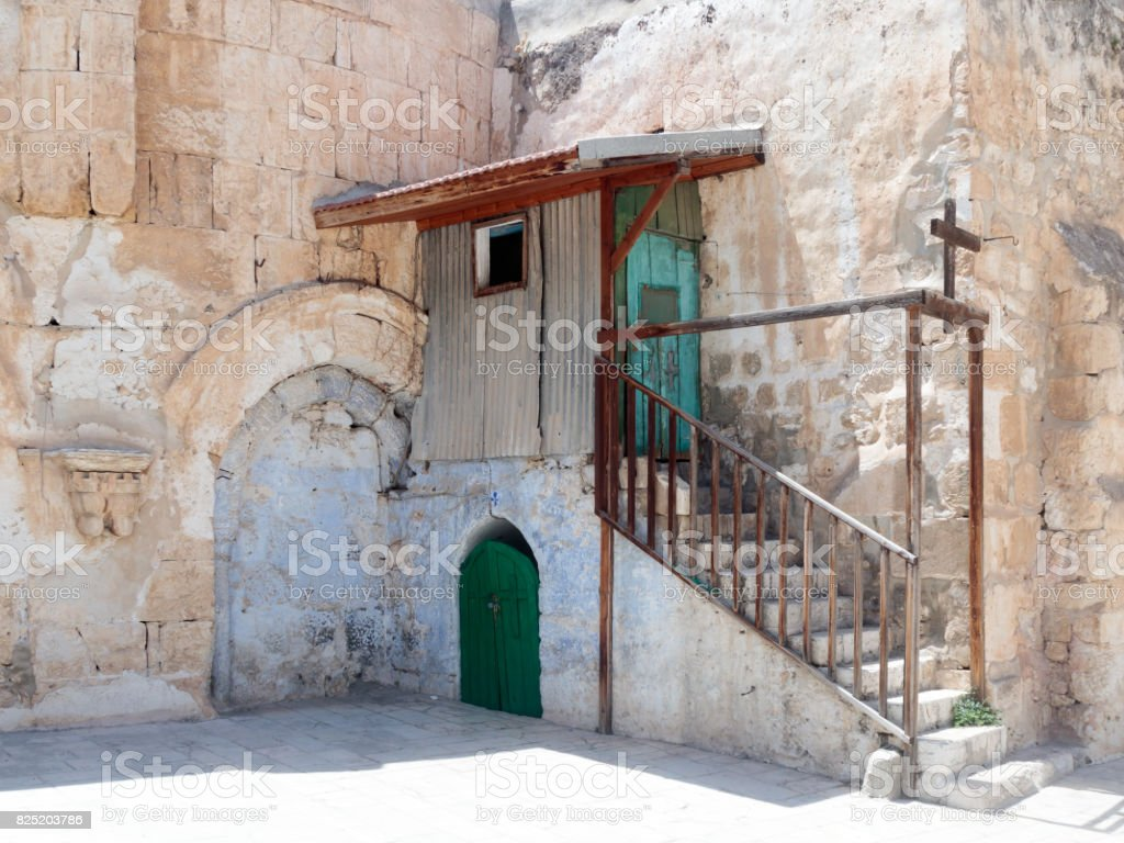 Steps  to the extension in the courtyard of the Dome in Ethiopian monastery near the Church of the Holy Sepulchre in the old city of Jerusalem, Israel. stock photo