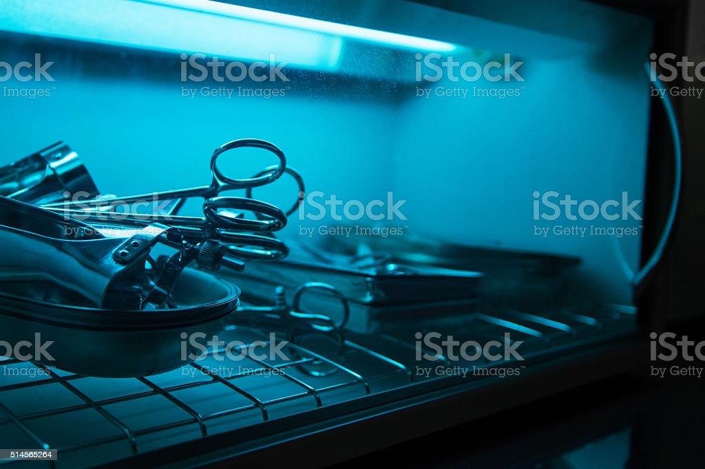 sterilizing the medical instrument stock photo