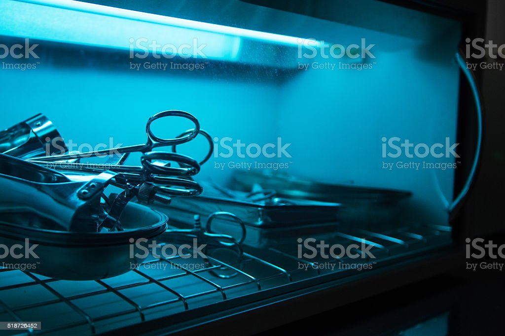 sterilizing the medical instrument stock photo