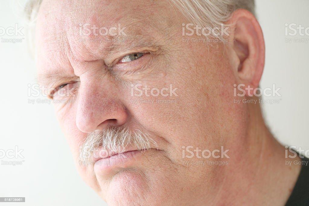 Stern and irritable senior man stock photo