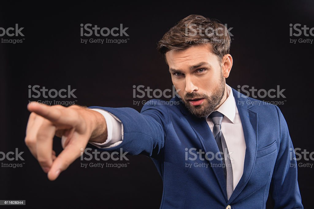 Stern boss commandeering with confidence stock photo