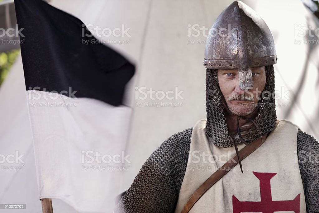 Stern Looking Knight Holding a Regimental Flag. stock photo